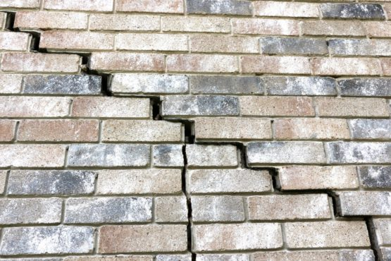 Cracks and separation of bricks from the house are another telltale sign of extreme foundation damage.